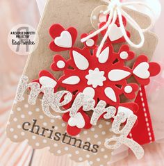 Christmas gift by Lisa Henke. Reverse Confetti stamp set: Winter Word Coordinates. Confetti Cuts: Winter Words, Layered Snowflake, and Thankful Tag. Frosted Pillow Box. Kraft Twine. Holiday Favor.