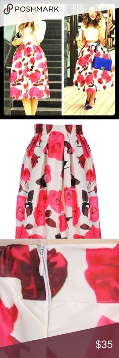 Beautiful floral structured midi skirt New! No flaws, never worn. Beautiful skirt made of satin detailed with pink roses! The waistband has a slight stretch and has a zipper. Would fit best on sizes S-M. Hasley's Boutique  Skirts Midi