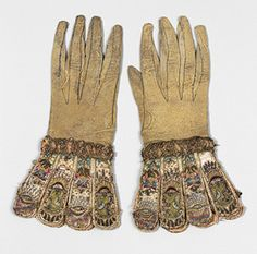 Pair of gloves, ca. 1600, English  Leather; satin worked with silk and metal thread, seed pearls; satin, couching, and darning stitches; metal bobbin lace; paper.  Despite the present fragile and somewhat degraded condition of these gloves, they retain enough of their sumptuous embroidery to convey the luxury of the highest quality needlework of the late Tudor and early Stuart era.