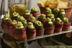 Cream cheese and guacomole stuffed jalapenos wrapped in bacon!