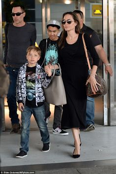 Angelina Jolie beams as she and kids Knox and Maddox arrive at JFK Airport   Daily Mail Online