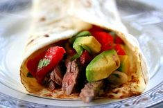 Carne asada is the thinly sliced, grilled beef served so often in tacos and burritos. This carne asada recipe is made with marinated, grilled skirt steak for flank steak. Serve with warm tortillas, avocados, and pico de gallo fresh tomato salsa.