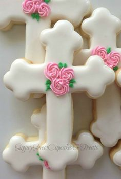 sweet crosses Cookies~                  By SugarySweetCookies. White, pink rosebud. They are perfect for any upcoming Holy event.You can have these the way they look or customized for you.Each cookie is made just specifically for you, never pre made.Cookies measure approximately 3.5 inches high and come individually sealed for max freshness and protection.