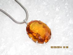Peter's yellow sapphire, about 48 carats. This stone saved his life.
