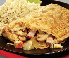 Pork, mushroom and onion rolled in a pastry parcel and served with rice