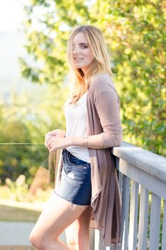 Long, thin cardigan over tee and shorts for summer-to-fall days