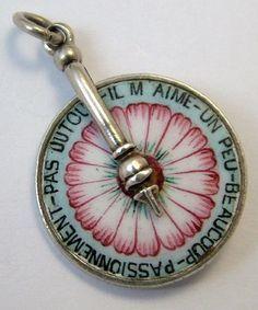 Silver & Enamel Daisy Spinning Wheel Charm He loves me.loves me a bit. Enamel Jewelry, Charm Jewelry, Antique Jewelry, Vintage Jewelry, Geek Jewelry, Victorian Jewelry, Gothic Jewelry, Vintage Silver, Fashion Jewelry