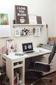 What a great work space!! That desk is incredible (look at all the storage!) and the shelf and hanging system...rethinking my work space now.