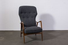 """This is a vintage Mid-Century highback lounge chair by Westnofa. It has a  lever on the side to lock it in five positions. This chairhas been  professionally reupholstered in a Danish charcoal grey wool.  Great condition with minor vintage wear on the frame. See images.  Measurements:  41.75""""H, 16""""H seat, 25.5""""W x 25""""deep  REQUEST A SHIPPING QUOTE  MAKE AN APPOINTMENT TO VIEW THIS ITEM"""