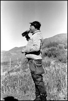 Sun Valley, Idaho. 1940. Ernest HEMINGWAY drinking bourbon during a duck hunt on John Meyer's farm//Robert Capa