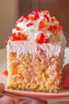 Weight Watchers friendly Strawberry Shortcake Poke Cake made with applesauce and pineapple chunks, filled with strawberry condensed milk and strawberry whipped topping for just 5 smart points per serving.