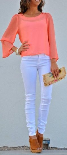 Blush blouse, white pants and brown wedges.