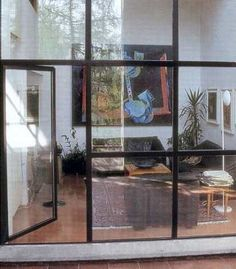 Casa Bianchi by Mario Botta. There is also a porch outside the living room via a glass door. This allows ventilation inside the space, as well as the connectivity to the outside.