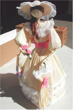 Corn husk doll with a little pink