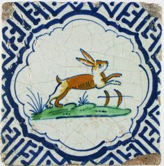 Antique Dutch Delft tile with a polychrome hare in a blue Wanli corner motifs, 17th century