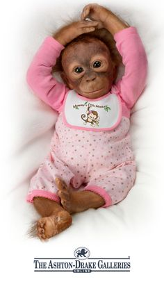 First-ever baby monkey doll by Artist Melissa McCrory with touch-activated feature to squeeze your finger