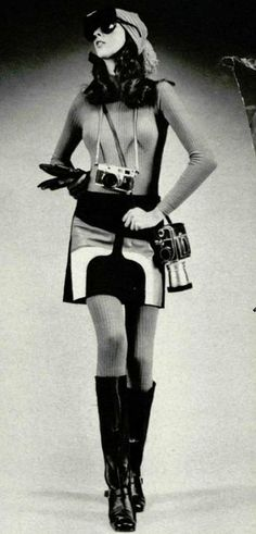 1964 - 1974. 1971 Hasselblad and a Leica. The woman in the photograph is wearing the popularized gogo boots and mini dress dress with pop pattern.