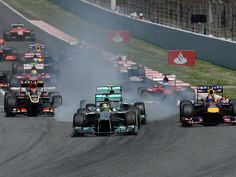Rosberg leads the field into Turn 1 for the Spanish GP
