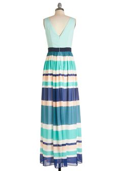 Beachy Inspiration Dress. You could easily wear this striped maxi dress - which boasts various shades of beachy blues and creams - to the shore, but you decide that todays gallery crawl is just as perfect! #blue #modcloth