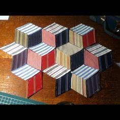 strandhuset:    stripey Tumbling Blocks quilt begins jbe200quilts.tumblr.com