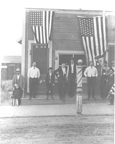 Men and boys in front of Al Oliver's Barbershop located on the southwest corner of Everett Street and Wilson Avenue in Glendale, circa 1900. Glendale Central Public Library. San Fernando Valley History Digital Library.