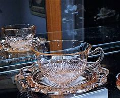 ITEM #RA-118 (Box R-6)  Hard to find pink depression glass cup and saucer set in the Old Colony aka Lace Edge pattern by Hocking Glass Co circa 1935-38.  Cup measures 3 3/4 diameter opening and stands 2 1/4 tall. Saucer is 6 in diameter.  Condition: Very good vintage condition with typical wear due to age and handling. No chips found. Slight roughness on the inside of the lace pattern on the saucer which occurred during the manufacturing process a lot of times with this pattern. Sta...