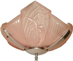Very rare and extremely gorgeous 1930's Art Deco glass ceiling light. Features three fan shaped moulded glass panels in frosted pink with ribbed motif and central nude female figure in relief. Set in original chrome art deco fitting.