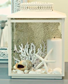 Add an outdoor battery operated light with a timer, fill with shells and a sea fan - cute for the front porch.