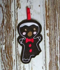 Gingerbread Man with Bite Out of Leg Felt Ornament by waggonswest