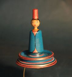 Wooden spinning doll. Wow! She's gorgeous!