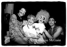 """April 1991: L-R: Club Kids Ernie Glam, MIchael Alig (curly blonde wig),  James St. James (in sunglasses) and friend (holding a chicken) pose for a photo at a party for actress Donna Douglas, best known for portraying Ellie May Clampett on """"The Beverly Hillbillies"""" TV show,  at Limelight nightclub  in New York City, New York. (Copyright 2010 Catherine McGann/ All Rights Reserved)."""