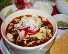 Pozole ~A a tasty, nutritious soup, with pork, hominy, onion, garlic. Garnished with Lettuce, onion, radishes.