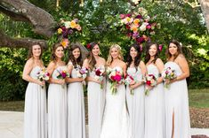 Gray bridesmaid dresses with punchy, bright bouquets