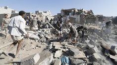 People search for survivors under the rubble of houses destroyed by an air strike near Sanaa Airport March 26, 2015. Saudi Arabia and Gulf region allies launched military operations including air strikes in Yemen on Thursday, officials said, to counter Iran-allied forces besieging the southern city of Aden where the U.S.-backed Yemeni president had taken refuge. REUTERS/Khaled Abdullah