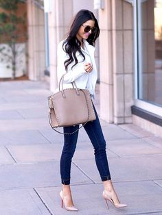 Shop this look on Lookastic:  http://lookastic.com/women/looks/white-biker-jacket-beige-tote-bag-blue-skinny-jeans-beige-pumps/8332  — White Leather Biker Jacket  — Beige Leather Tote Bag  — Blue Skinny Jeans  — Beige Leather Pumps
