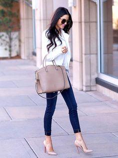 Shop this look on Lookastic:  http://lookastic.com/women/looks/white-biker-jacket-beige-tote-bag-blue-skinny-jeans-beige-pumps/8332  — White Leather Biker Jacket  — Beige Leather Tote Bag  — Blue Skinny Jeans  — Beige Leather Pumps