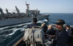 ARABIAN GULF (March 10, 2015) Navy Counselor 1st class Jorge Delgado stands a communication watch to relay information aboard the guided-missile destroyer USS Mitscher (DDG 57) during a replenishment-at-sea with the Military Sealift Command combat support ship USNS Rainier (T-AOE 7). Mitscher is deployed in the U.S. 5th Fleet area of responsibility supporting Operation Inherent Resolve, strike operations in Iraq and Syria as directed, maritime security operations and theater security…