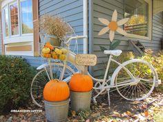 fall bicycle garden display...paint your bike to match the season...make sure you have a metal bike basket to display autumn items...pick up a few fall items to display on or next to your bike at a thrift store, consignment store or garage sale