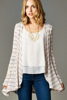 Style for over 35 ~ statement necklace accents an airy ivory top with swing cardigan