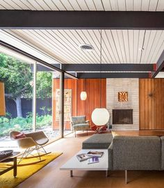 Basement Inspiration - DC Hillier's MCM Daily - The Bobertz House. Classic Mid Century Modern architecture and furnishings. Love that grey sofa