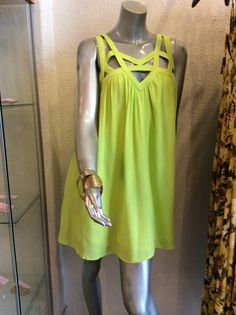 Easy flow lime green dress with cutouts in the collar