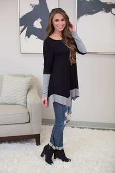 This stunning asymmetrical hem tunic is perfect for relaxing in style all season long! We're in love with the beautiful combination of black on the bodice and heather grey on the sleeves and bottom he