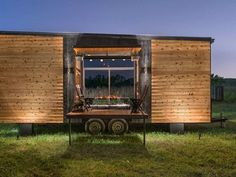 Luxurious Alpha tiny house opens wide on both sides to let the outdoors in