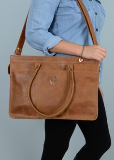 A new favourite online and in select stores. #Eco-leather and #fairtrade, this stunning bag works as a briefcase or purse.