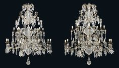 A PAIR OF NORTH ITALIAN SILVERED, MOULDED, CUT-GLASS AND CRYSTAL SIXTEEN-LIGHT CHANDELIERS -  19TH CENTURY