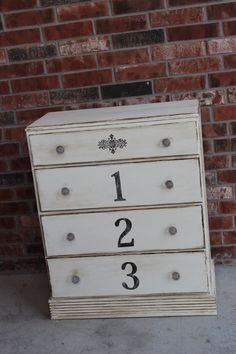 Radiantly Redeemed -Four drawer dresser painted in ASCP Old White, dark wax, and stenciled numbers.  LOVE this- could go in so many places!