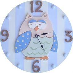 Cute owl wall clock for a baby boy's nursery.