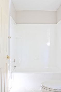 How to update an UGLY bathtub - Rustoleum tub and tile refinishing paint kit. Remove grout, sand, and paint on