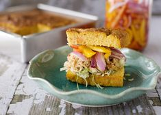 slow cooker BBQ chicken sandwiches on sweet potato cornbread with pickled bell peppers and onions...WOW, this sounds amazing.