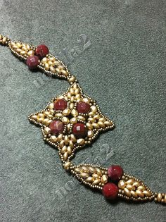 Red faceted czechbeads and golden superduos /twinbeads beaded bracelet.